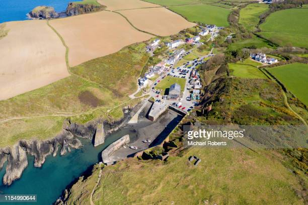 aerial view of porthgain harbour, near st davids, pembrokeshire from a drone - st davids stock pictures, royalty-free photos & images