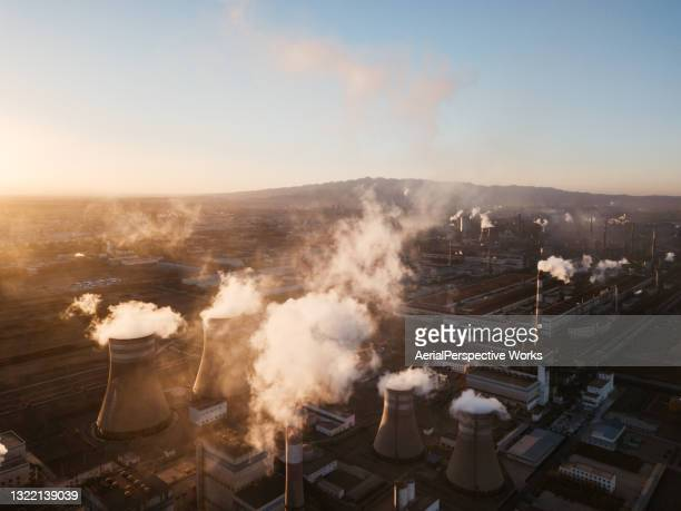 aerial view of power station at sunset - coal fired power station stock pictures, royalty-free photos & images