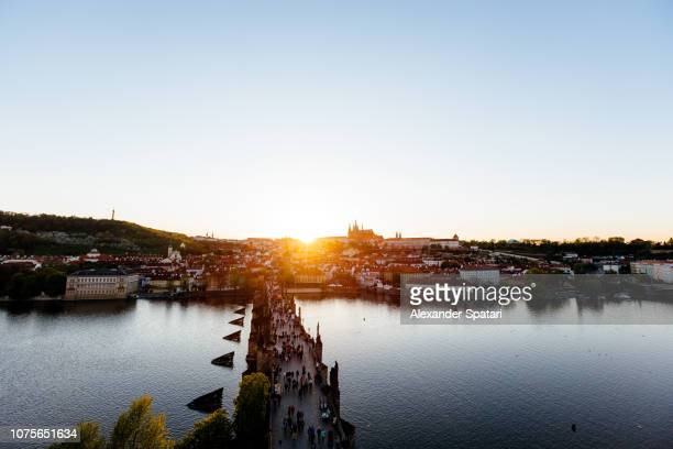 Aerial view of Prague skyline with Charles bridge, Vltava river and Mala Strana during sunset, Czech Republic