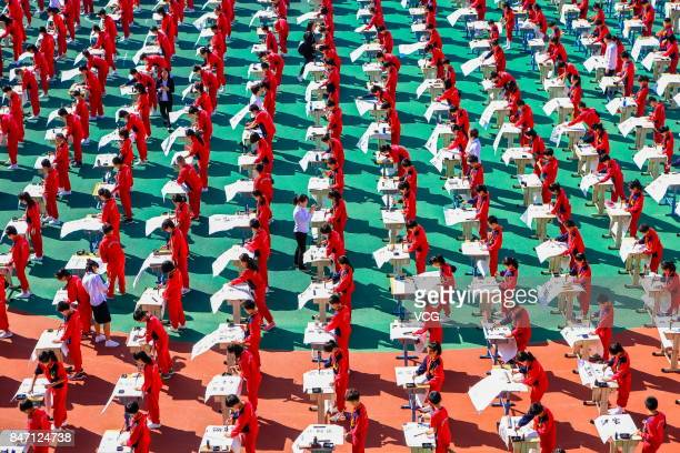Aerial view of primary school students writing Chinese calligraphy on September 14 2017 in Shenyang Liaoning Province of China About 1000 students...
