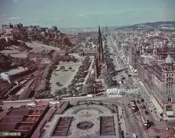 Aerial view of Princes Street, the Scott Monument, Waverley Station, Princes Gardens and Edinburgh Castle in the City of Edinburgh, capital of...