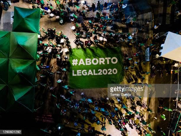Aerial view of pro-choice activists displaying a banner that reads in Spanihs 'Legal Abortion' outside the National Congress as Deputies vote on a...