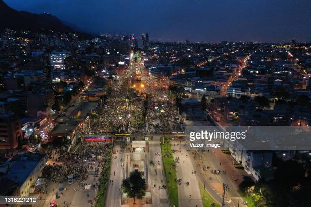 Aerial view of protesters gathered during a protest against Ivan Duque's administration at Monumento a Los Héroes on May 15, 2021 in Bogota,...