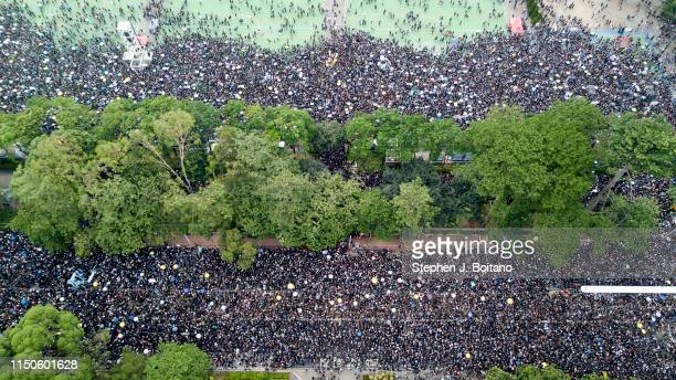 Aerial view of protesters marching in a mass protests rally from Victoria Park to Government Complex in Hong Kong. Estimated 2 million people...