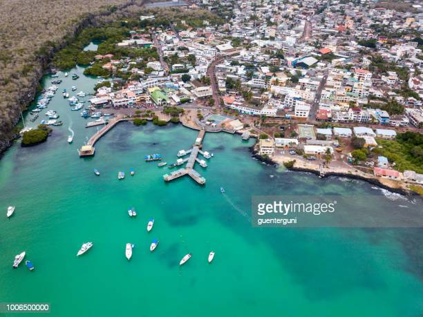 aerial view of puerto ayora, santa cruz island, galapagos - santa cruz island galapagos islands stock pictures, royalty-free photos & images