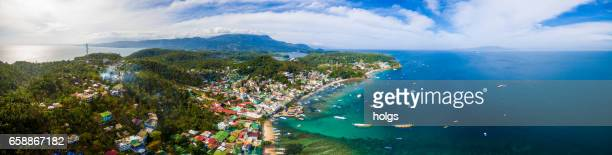 aerial view of puerto galera in mindoro island, philippines - aceh stock pictures, royalty-free photos & images