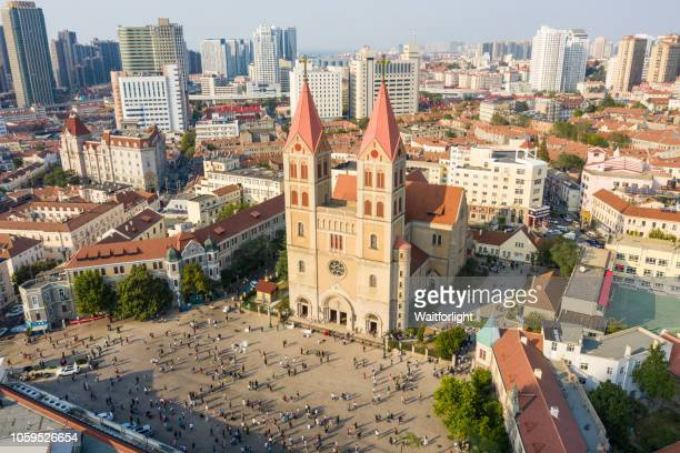 aerial view of qingdao cityscape with catholic church - qingdao beach stock pictures, royalty-free photos & images