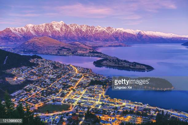 aerial view of queenstown at dusk with lake wakatipu and the remarkables, new zealand - new zealand bildbanksfoton och bilder