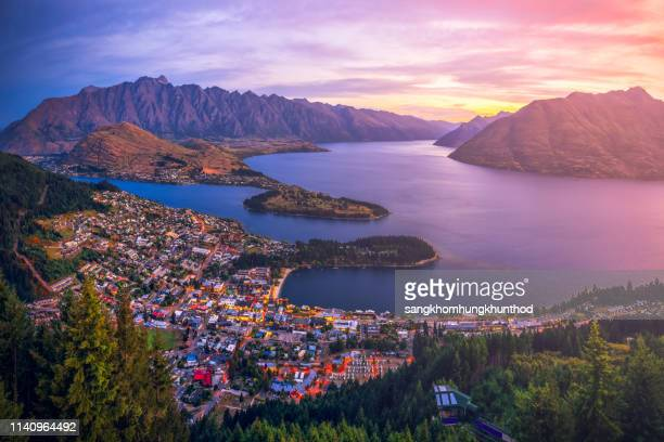 aerial view of queenstown at sunset, south island, new zealand - queenstown stock pictures, royalty-free photos & images