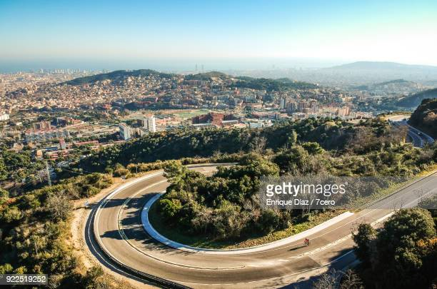 Aerial view of Rabassada road in the Collserola Natural Park with Barcelona in the background.