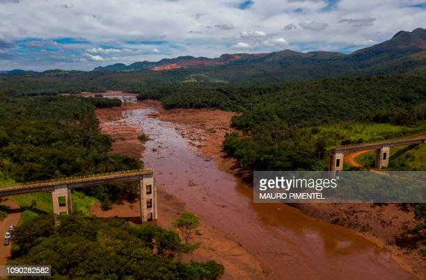 TOPSHOT Aerial view of rail bridge taken down by a mudslide after the collapse two days ago of a dam at an ironore mine belonging to Brazil's giant...