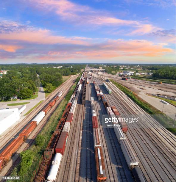 aerial view of railroad rail yard, many trains, tracks.