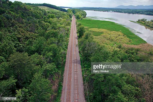 aerial view of railroad tracks and adjacent land just off the hudson river, near hudson, columbia county, new york - river hudson stock pictures, royalty-free photos & images