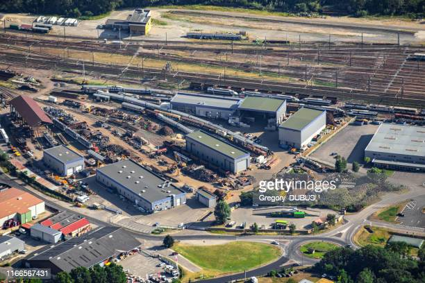 aerial view of railway warehouses in france, with several trains and wagons on railroad track, freight transportation - rail freight stock pictures, royalty-free photos & images