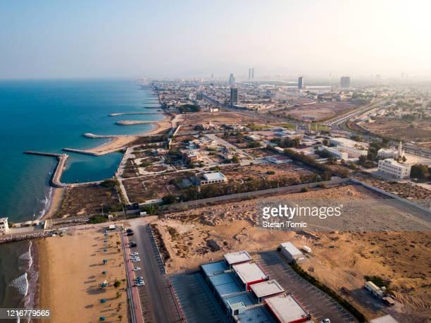 aerial view of ras al khaimah city coastline in the uae - ras al khaimah stock pictures, royalty-free photos & images
