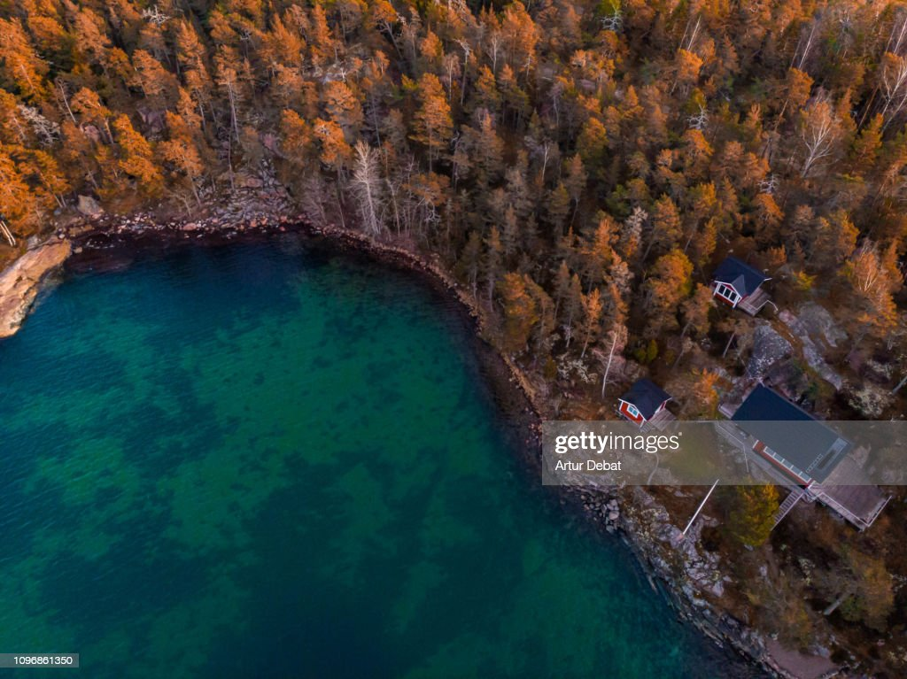 Aerial view of red houses with the sea and nature in the Stockholm archipelago. : Stock Photo