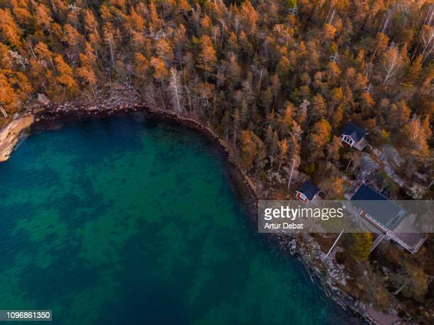 aerial view of red houses with the sea and nature in the stockholm archipelago. - stockholm stock-fotos und bilder
