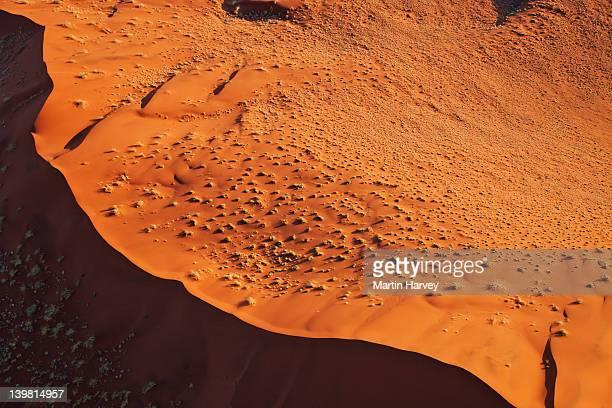 Aerial view of red sand dunes at Sossusvlei, Namib desert. Namib-Naukluft National Park, Namibia, Africa