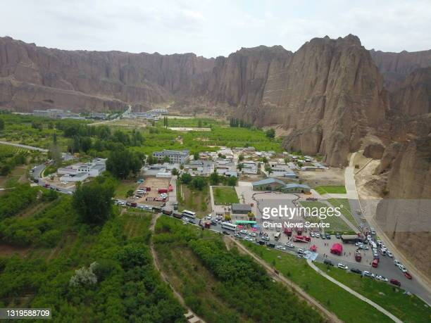 Aerial view of rescue cars at the Yellow River Stone Forest tourist site of Jingtai County on May 23, 2021 in Baiyin, Gansu Province of China. A...