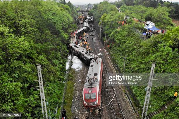 Aerial view of rescuers working at the scene after a passenger train derailed at Yonghua village on March 30, 2020 in Chenzhou, Hunan Province of...