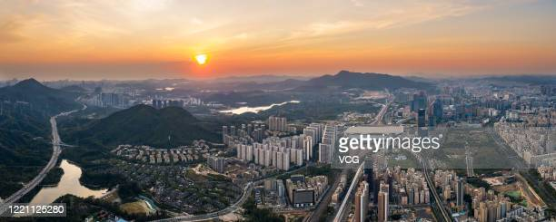Aerial view of residential and commercial buildings and Shenzhen North Railway Station right at sunset on April 12 2020 in Shenzhen Guangdong...
