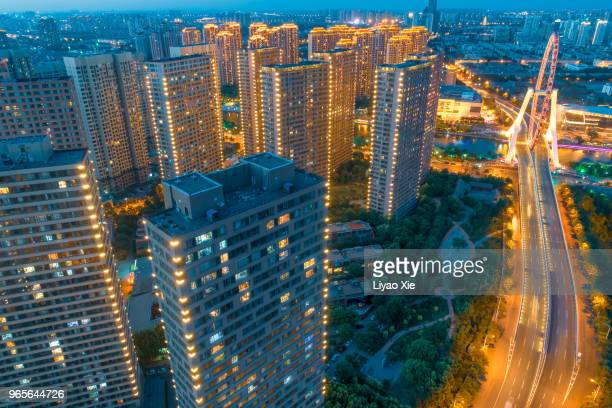 aerial view of residential building and ferris wheel - liyao xie stock pictures, royalty-free photos & images