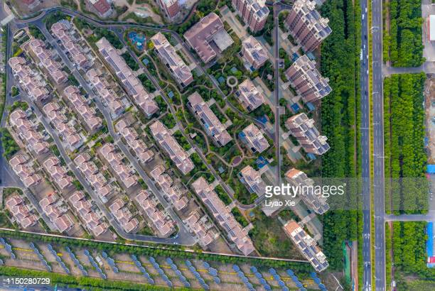 aerial view of residential building and road - liyao xie stock pictures, royalty-free photos & images