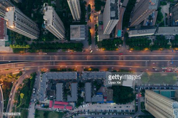 aerial view of residential building - overhead view of traffic on city street tokyo japan stock photos and pictures