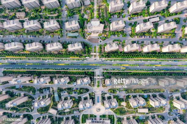 aerial view of residential buildings and road - liyao xie stock pictures, royalty-free photos & images