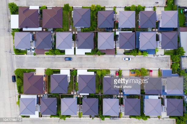 aerial view of residential houses and driveways neighborhood. housing community development. - grounds stock pictures, royalty-free photos & images