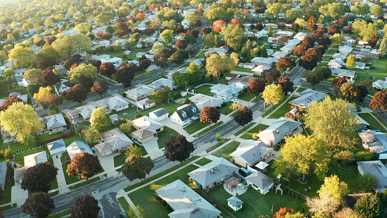 Aerial view of residential houses at autumn (october). American neighborhood, suburb. Real estate, drone shots, sunset, sunny morning,  sunlight, from above 1181134074