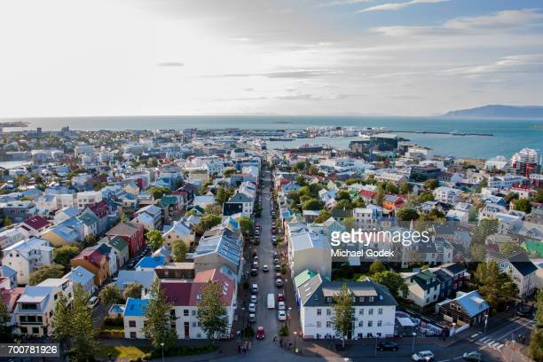aerial view of reykjavik iceland with ocean in the distance - reykjavik stock pictures, royalty-free photos & images