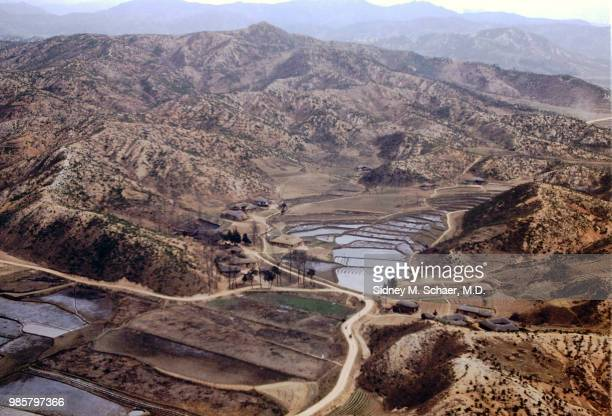 Aerial view of rice paddies in a valley South Korea January 1952