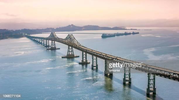 aerial view of richmond-san rafael bridge during sunrise - san rafael california stock pictures, royalty-free photos & images