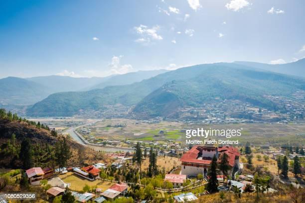 aerial view of rinpung dzong monastery, bhutan springtime - paro stock photos and pictures