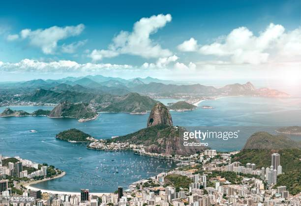 aerial view of rio de janeiro brazil with guanabara bay and sugar loaf - copacabana beach stock pictures, royalty-free photos & images