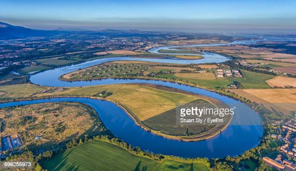 aerial view of river against sky - curve stock pictures, royalty-free photos & images