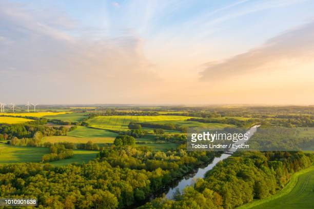 aerial view of river amidst green landscape against sky - mecklenburg vorpommern stock pictures, royalty-free photos & images