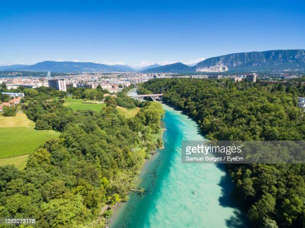 aerial view of river amidst trees against clear blue sky - geneva switzerland stock pictures, royalty-free photos & images