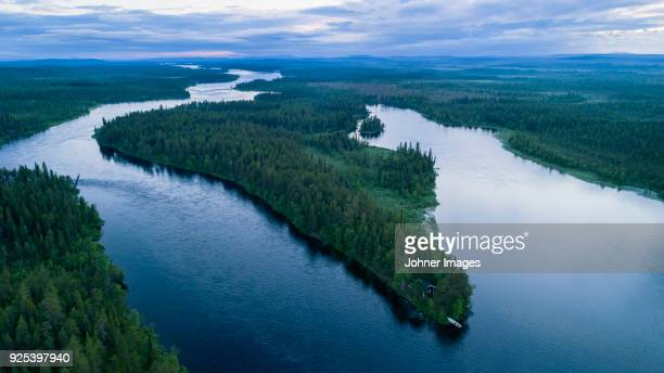 aerial view of river and forest - norrbotten province stock photos and pictures