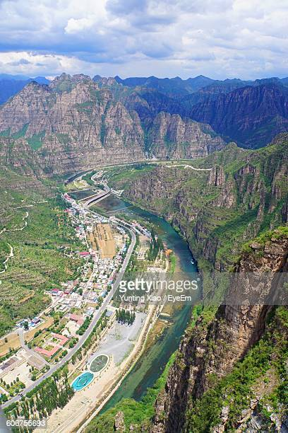 Aerial View Of River By Mountains
