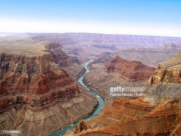aerial view of river flowing amidst rock formations - category:grand_canyon_national_park stock pictures, royalty-free photos & images