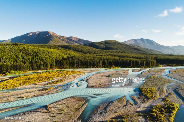 aerial view of river flowing through mountain ridge. - marlborough new zealand stock pictures, royalty-free photos & images