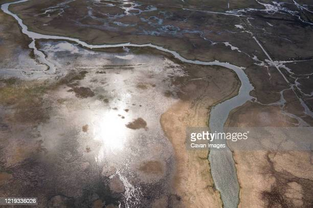 aerial view of river in southern iceland - drainage_basin stock pictures, royalty-free photos & images