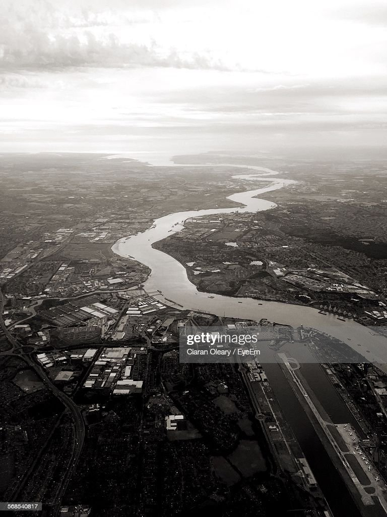 Aerial View Of River On Landscape Against Sky : Stock Photo