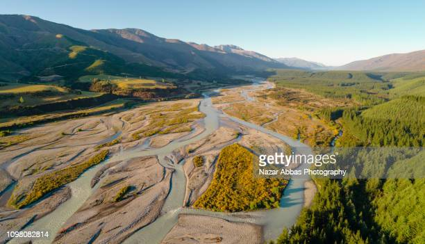 aerial view of river through mountain ridge. - blenheim new zealand stock pictures, royalty-free photos & images