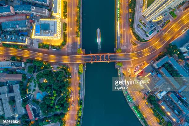 aerial view of riverbank and city - liyao xie stock pictures, royalty-free photos & images