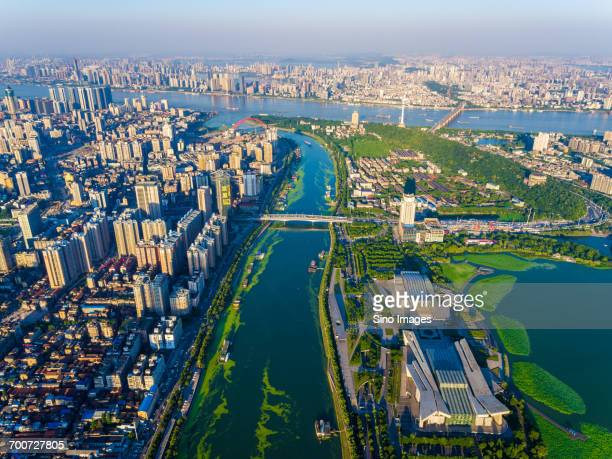 aerial view of riverside city - wuhan stock photos and pictures