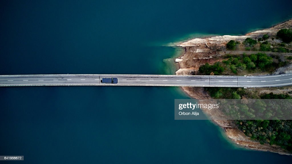 Aerial View of road above a lake : Stock Photo