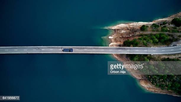 Aerial View of road above a lake